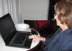 Aileen studies her website. Photo by Sandy Arlinghaus.
